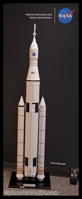 Scale Model of Space Launch System including the main rocket, Orion capsule, and pair of solid rocket motors.