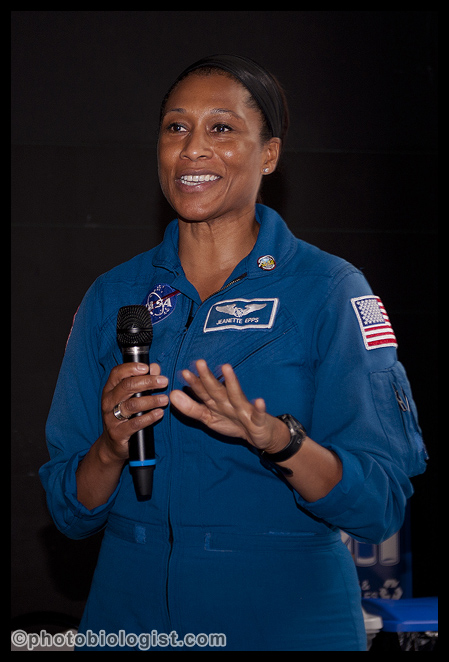 For this shot of NASA Astronaut Jeanette Epps, I was able to get closer and use a shorter lens and fill flash, I got better color and more detail - but my shutter speeds were still slow enough that I got some blurring as the subjects moved. Nikon D3, Nikkor 28-85 @ 85 mm, f/4.5, 1/60th second, ISO 500, bounced flash as main light.