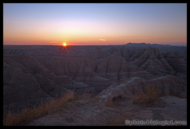 The sun breaking the horizon in the Badlands.